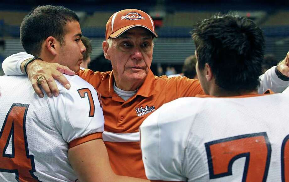 Madison coach Jim Streety consoles his players after their loss to Fort Bend Hightower in the Alamodome on Saturday, December 10, 2011.  Tom Reel/Staff Photo: TOM REEL, Express-News / treel@express-news.net