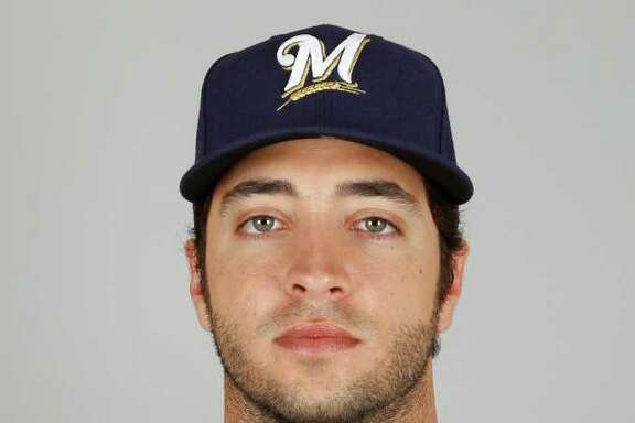 """FILE - This Feb. 24, 2011, file photo, shows Milwaukee Brewers' Ryan Braun in Phoenix. ESPN is reporting that National League MVP Braun has tested positive for a performance-enhancing drug and is facing a 50-game suspension. A spokesman for Braun said in a statement issued to ESPN and The Associated Press by his representatives, Creative Artists Agency, that """"there are highly unusual circumstances surrounding this case which will support Ryan's complete innocence."""" (AP Photo/Morry Gash, File)"""