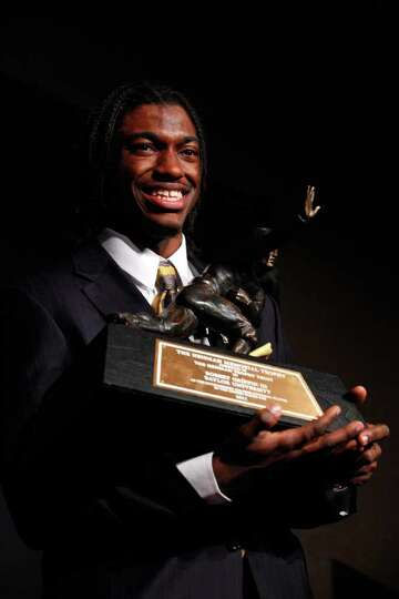 NEW YORK, NY - DECEMBER 10: Robert Griffin III of the Baylor Bears poses with the trophy after being