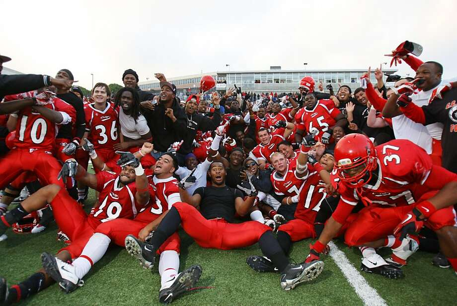 City College of San Francisco celebrates after beating Mt. San Antonio College for the State Championship, 52-42, at the City College of San Francisco Stadum in San Francisco, Calif., on Saturday, Dec. 10, 2011.  Ran on: 12-11-2011 CCSF's players celebrate holding off Mount San Antonio College for the state football title. Ran on: 12-11-2011 CCSF's players celebrate holding off Mount San Antonio College for the state football title. Photo: Thomas Webb, The Chronicle