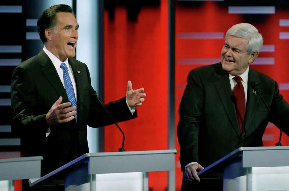 Republican presidential candidates former Massachusetts Gov. Mitt Romney, left, and former Speaker of the House Newt Gingrich, right, take part in the Republican debate, Saturday, Dec. 10, 2011, in Des Moines, Iowa. Photo: AP