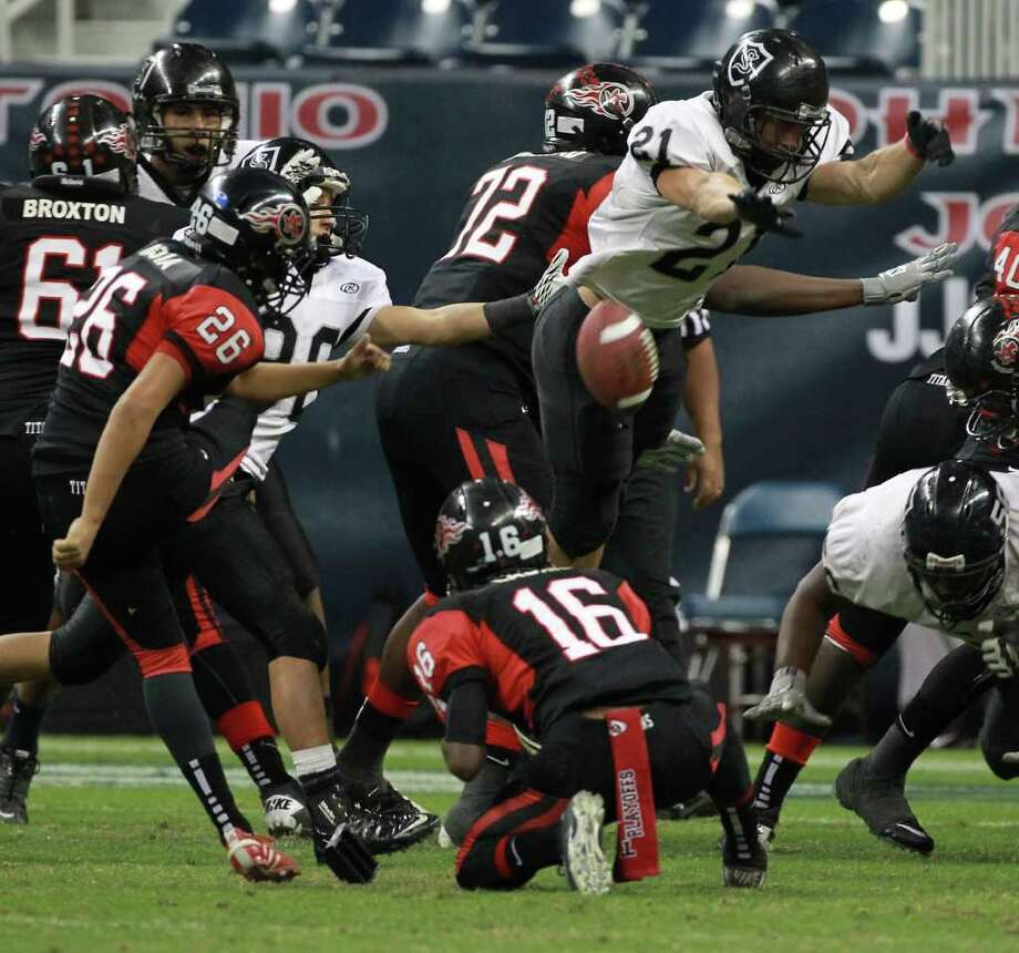 Cibolo Steele High School's Roy Russell blocks Omar Mejia's extra point during the fourth quarter of a Class 5-A Division II semifinal high school football game, Saturday, Dec. 10, 2011, in Reliant Stadium in Houston. Steele High won 51-31. Photo: Nick De La Torre, Houston Chronicle / © 2011  Houston Chronicle