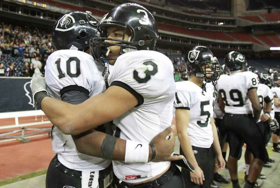Cibolo Steele High School players Tommy Armstron, left, and Evan Lyons hug as time runs out during the fourth quarter of a Class 5-A Division II semifinal high school football game, Saturday, Dec. 10, 2011, in Reliant Stadium in Houston. Steele High won 51-31. Photo: Nick De La Torre, Houston Chronicle / © 2011  Houston Chronicle