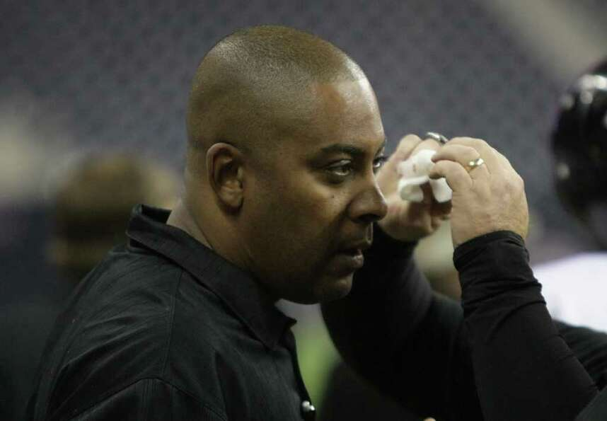 Cibolo Steele High School head coach Michael Jinks gets a cut on his eye attended to after being bow