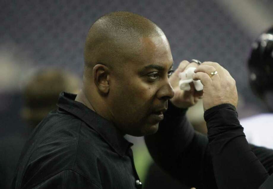 Cibolo Steele High School head coach Michael Jinks gets a cut on his eye attended to after being bowled over by players during the fourth quarter of a Class 5-A Division II semifinal high school football game against Port Arthur Memorial High School, Saturday, Dec. 10, 2011, in Reliant Stadium in Houston. Steele High won 51-31. Photo: Nick De La Torre, Houston Chronicle / © 2011  Houston Chronicle