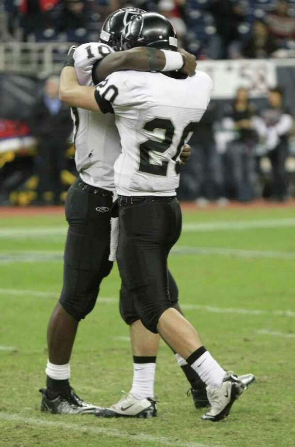 Cibolo Steele High School's Tommy Armstrong, left (10) Matthew Mayle embrace as time runs out of their Class 5-A Division II semifinal high school football game against Port Arthur Memorial High School, Saturday, Dec. 10, 2011, in Reliant Stadium in Houston. Steele High won 51-31. Photo: Nick De La Torre, Houston Chronicle / © 2011  Houston Chronicle
