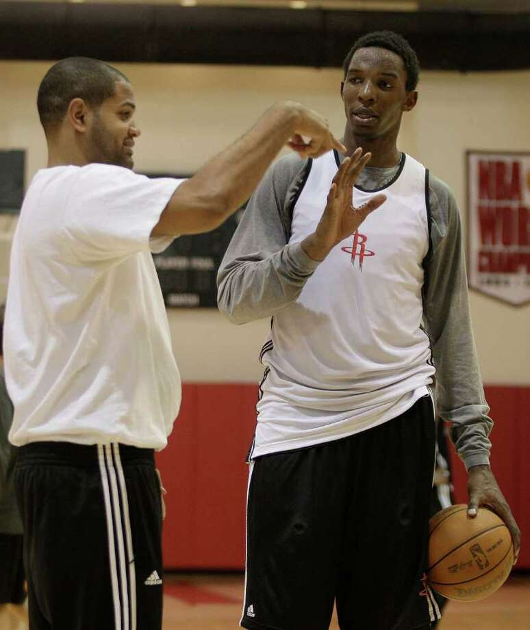 WORDS OF WISDOM: Center Hasheem Thabeet, right, gets a few pointers from Rockets assistant head coach J.B Bickerstaff during training camp at Toyota Center. Photo: Thomas B. Shea / © 2011 Thomas B. Shea