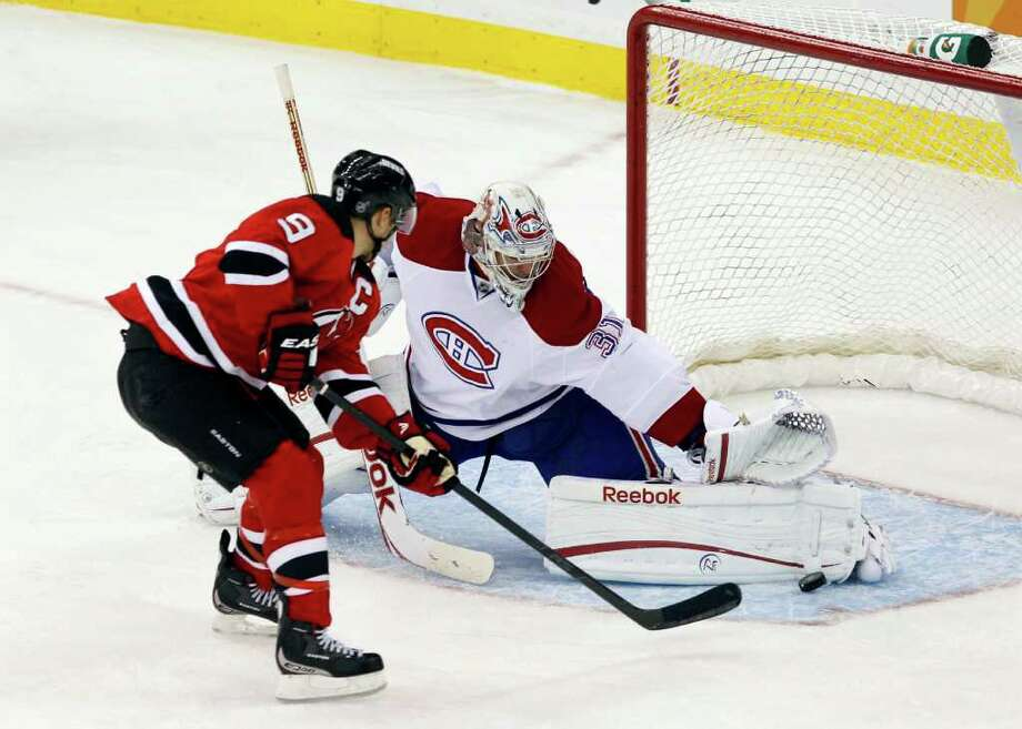 Montreal Canadiens goalie Carey Price (31), blocks a penalty shot by New Jersey Devil's Zach Parise (9) during the third period of an NHL hockey game in Newark, N.J., Saturday, Dec. 10, 2011. The Canadiens won 2-1. (AP Photo/Mel Evans) Photo: Mel Evans