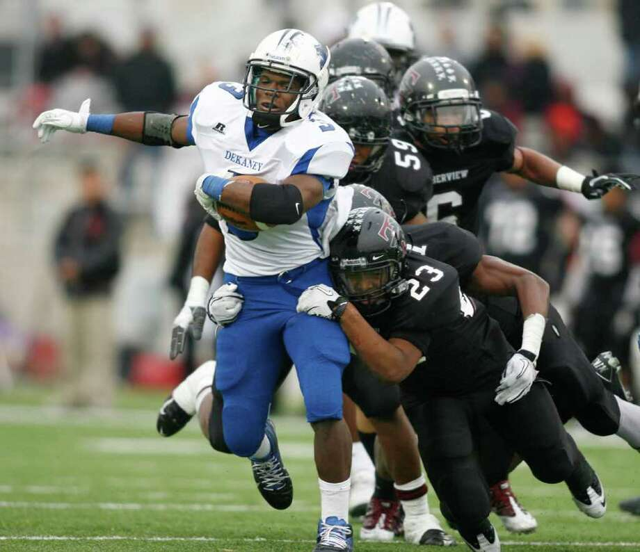 Dekaney running back Trey Williams, left, drags Mansfield Timberview defenders with him en route to a six-touchdown performance Saturday in Round Rock. Photo: Erich Schlegel / ©2011 Erich Schlegel