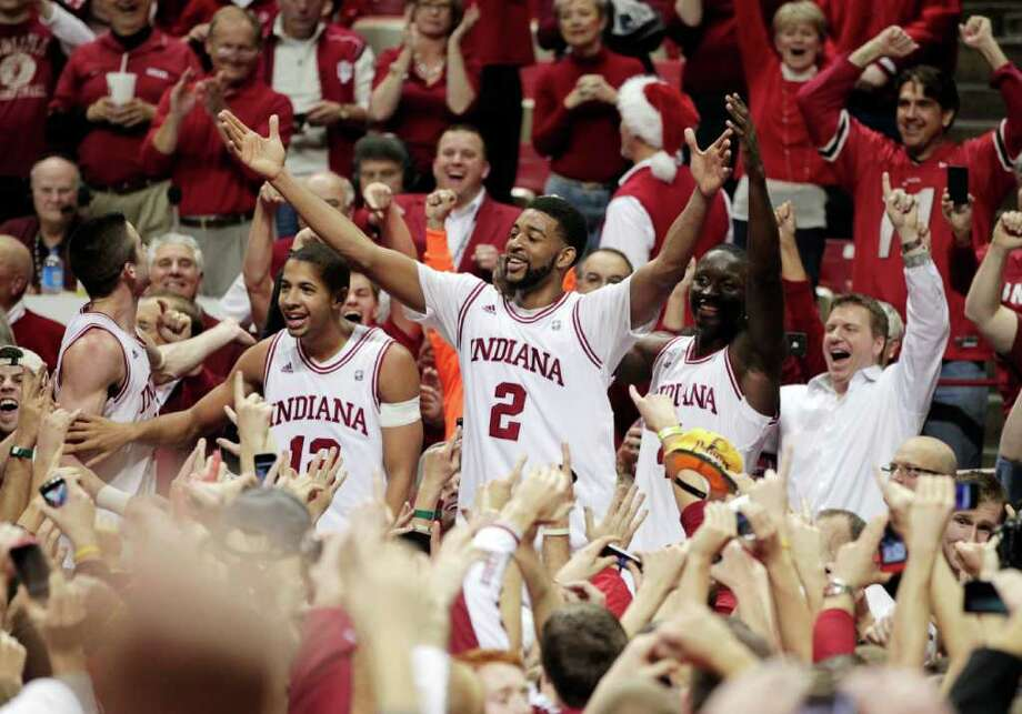 Indiana's Christian Watford (2) celebrates with teammates, from left, Will Sheehey, Verdell Jones III and Victor Oladipo after Indiana defeated Kentucky 73-72 in an NCAA college basketball game, Saturday, Dec. 10, 2011, in Bloomington, Ind. Watford hit a 3-pointer at the buzzer to seal the victory. (AP Photo/Darron Cummings) Photo: Darron Cummings