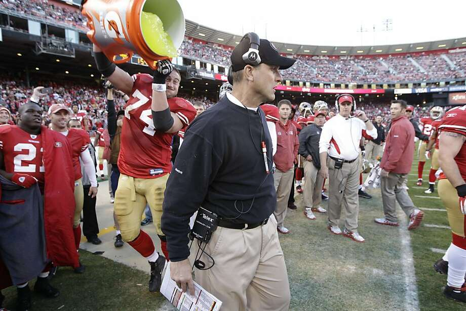 San Francisco 49ers offensive tackle Joe Staley (74) dumps gatorade on head coach Jim Harbaugh during the fourth quarter of an NFL football game against the St. Louis Rams in San Francisco, Sunday, Dec. 4, 2011. The 49ers won 26-0. (AP Photo/Paul Sakuma) Photo: Paul Sakuma, AP