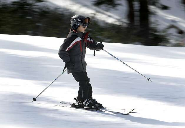 A young skier speeds down the Drifter run at Northstar California Resort in Truckee, Calif. on Saturday, Dec. 10, 2011. Extensive snowmaking equipment has allowed Northstar to open 19 of its 97 runs despite a shortage of natural snow. Photo: Paul Chinn, The Chronicle