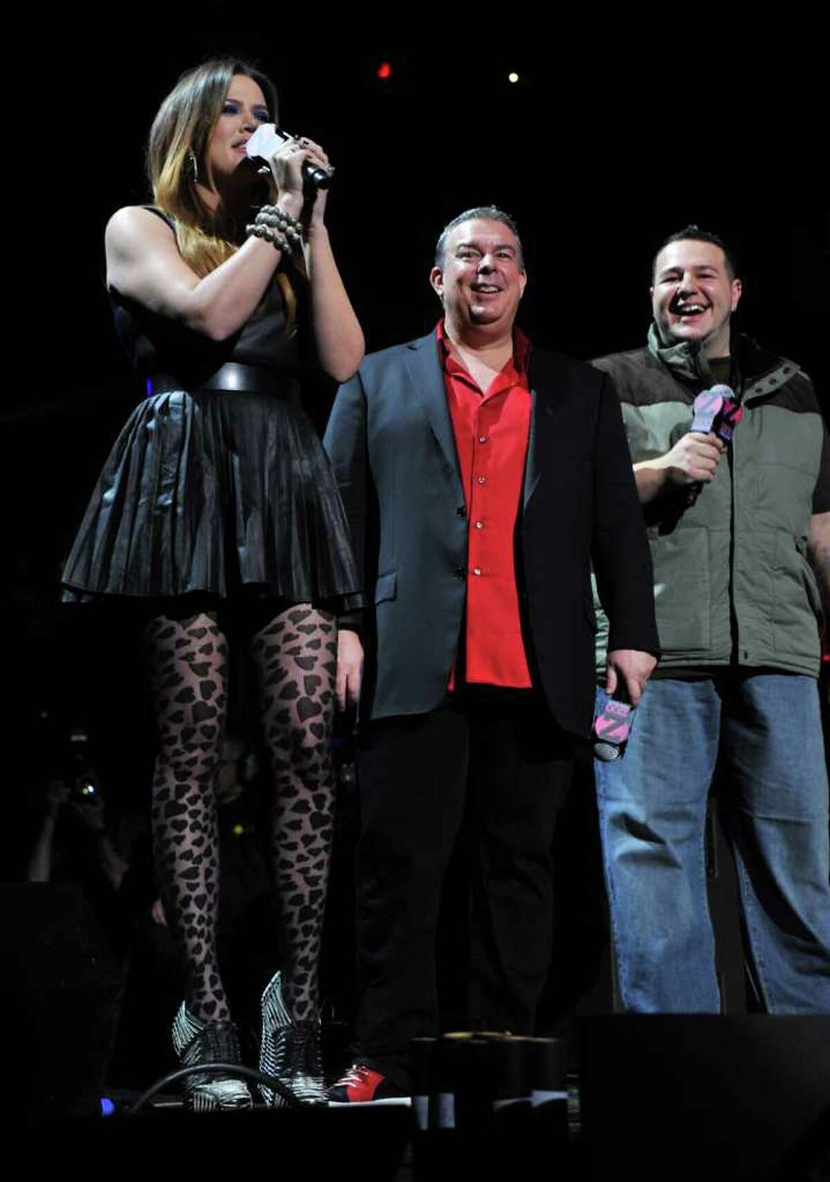 NEW YORK, NY - DECEMBER 09: Khloe Kardashian, Elvis Duran and Mo' Bounce speak onstage during Z100's Jingle Ball 2011, presented by Aeropostale at Madison Square Garden on December 9, 2011 in New York City. (Photo by Stephen Lovekin/Getty Images)