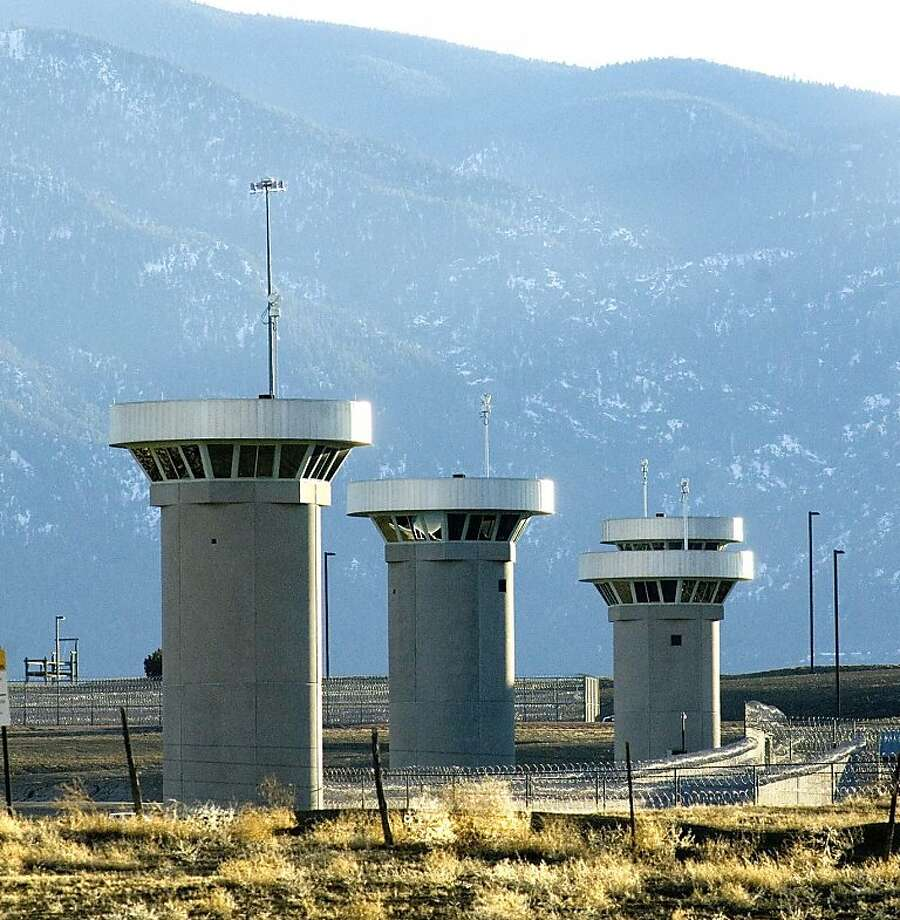 Guard towers loom over the administrative maximum security facility, the highest security area at the Federal Prison in Florence, Colo., Wednesday, Feb 21, 2007. U.S. Attorney General Alberto Gonzales toured the prison, known as the Supermax, with Colorado state and federal legislators following complaints by staff and local residents about the level of security at the facility. (AP Photo/Pueblo Chieftain, Chris McLean) Photo: Chris Mclean, ASSOCIATED PRESS
