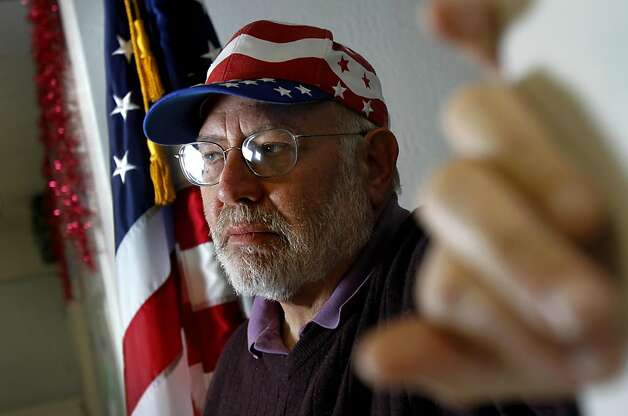 "Ellis Goldberg of Danville, the president of the Tri Valley Democratic Club and an active 99 percenter, disagrees with some of the strategies of Occupy Oakland.  ""Basically, we're not as confrontational,"" he said, ""When you go in to the port of Oakland and close it down, you're using a bat, and you're hitting the 99 percenters.""  He is photographed setting up for the club's holiday party at the International Brotherhood of Electrical Workers 595 union headquarters in Dublin, Calif., Friday, December 9, 2011. Photo: Sarah Rice, Special To The Chronicle"