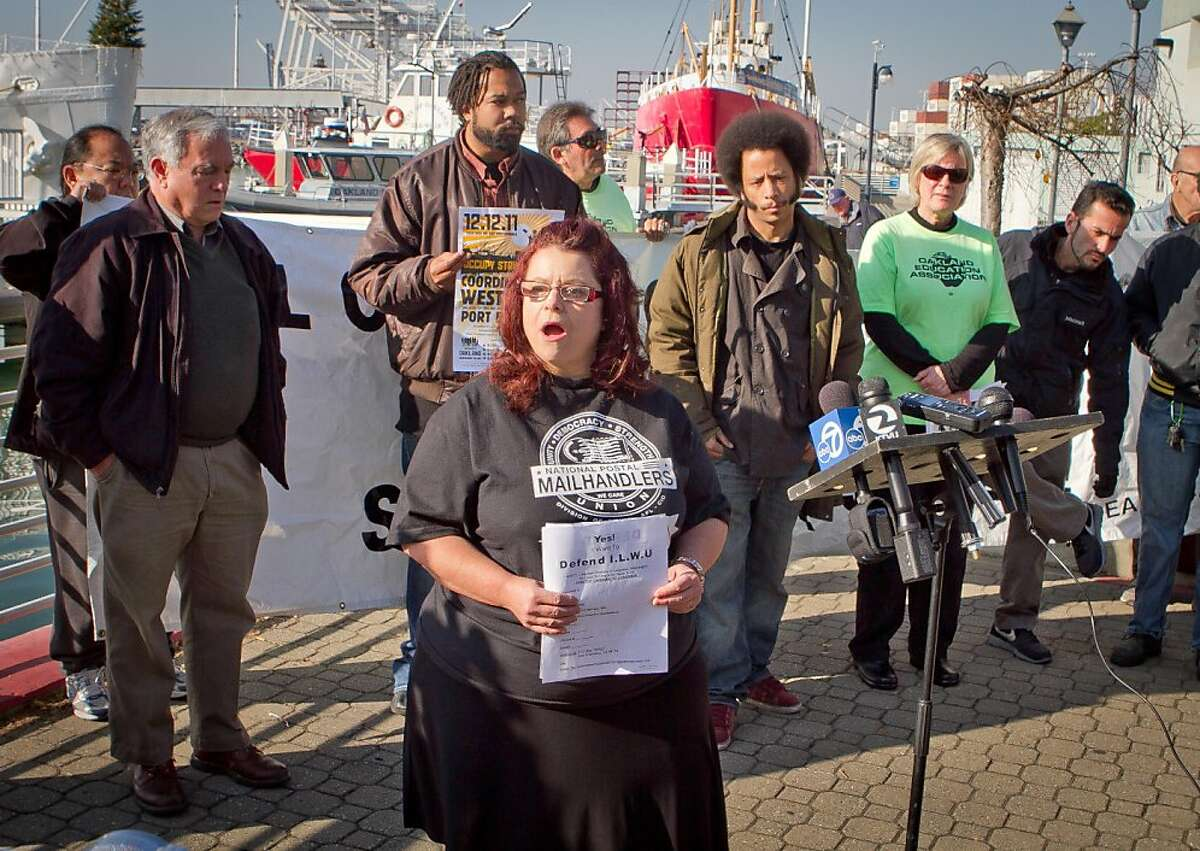 Postal worker Kimberly Rojas speaks at a press conference organized by Occupy Oakland on plans about shutting down the Port of Oakland in Oakland, Calif., on Friday, December 9, 2011.