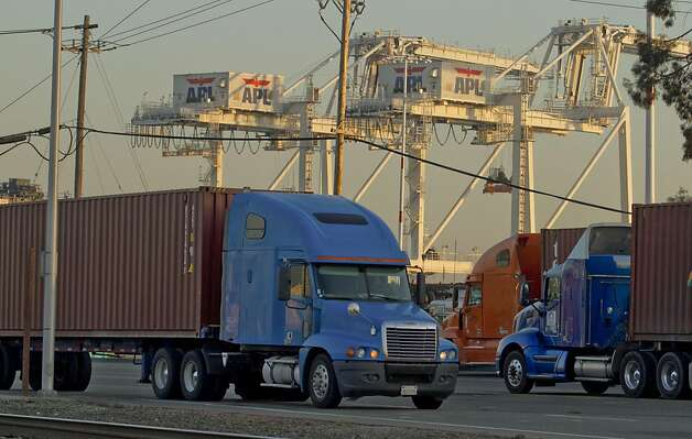 Trucks move containers in and out of the Port of Oakland in Oakland, Calif., on Friday, December 9, 2011. Story about how Occupy Oaklland plans to shut down the port on December 12th. Photo: John Storey, Special To The Chronicle