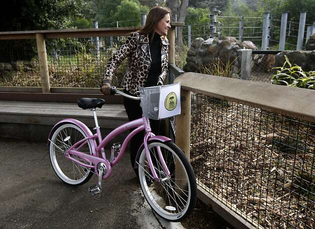 Zoo director Tanya Peterson rode her bicycle to the hippopotamus exhibit to see the newest resident at the San Francisco Zoo in San Francisco, Calif., on Friday, Jan. 7, 2011. Peterson rides the bike to travel throughout the zoo grounds. Photo: Paul Chinn, The Chronicle