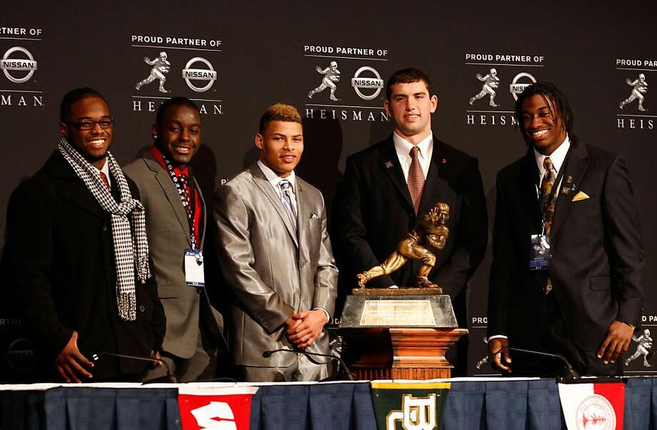 NEW YORK, NY - DECEMBER 10:  (L-R) Heisman Trophy finalists running back Trent Richardson of the Alabama Crimson Tide, running back Montee Ball of the Wisconsin Badgers, cornerback Tyrann Mathieu of the LSU Tigers, Andrew Luck of the Stanford University Cardinal and quarterback Robert Griffin III of the Baylor Bears pose with the Heisman Trophy after a press conference at The New York Marriott Marquis on December 10, 2011 in New York City.  (Photo by Jeff Zelevansky/Getty Images) Photo: Jeff Zelevansky, Getty Images