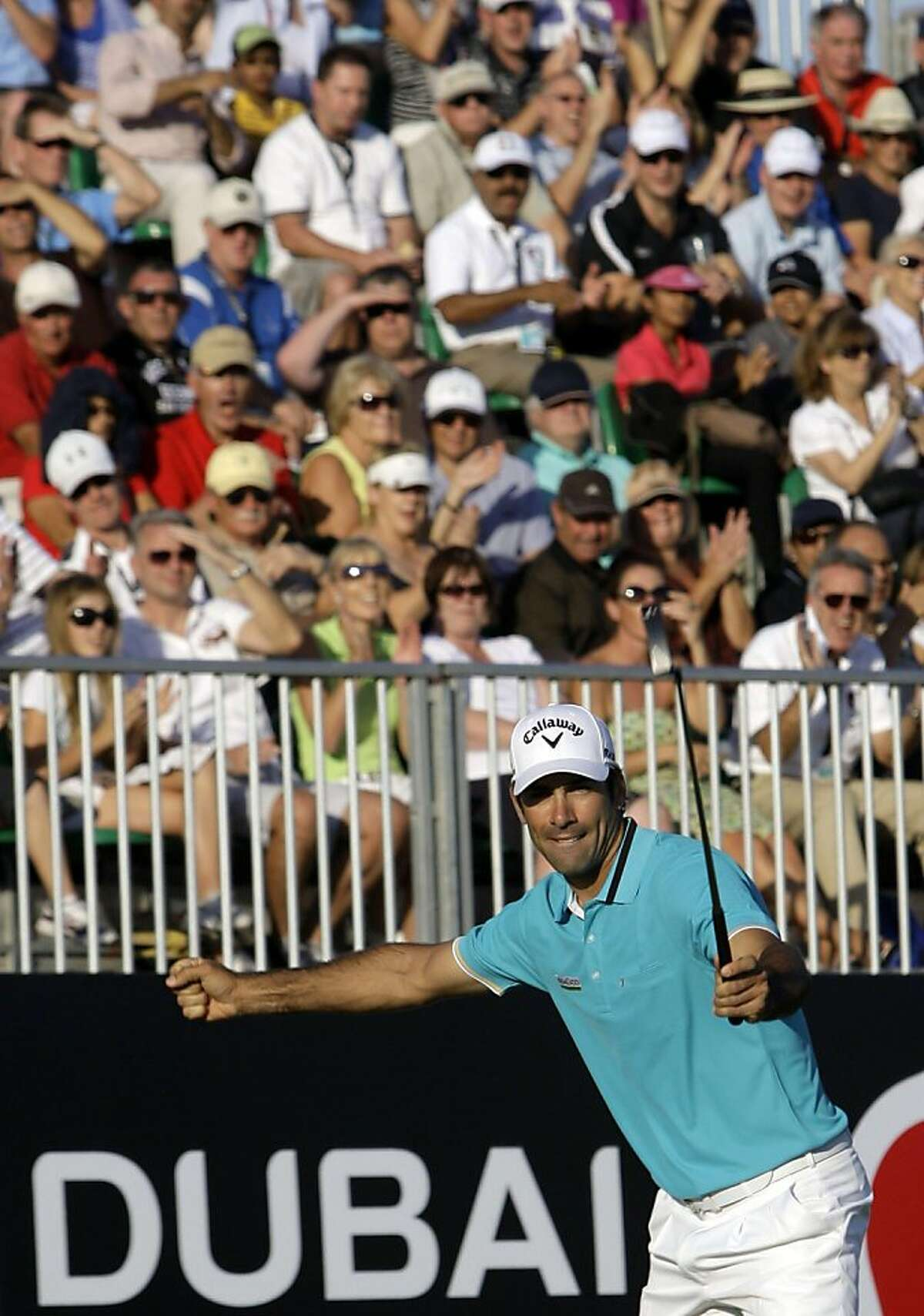 Alvaro Quiros from Spain and leader of the second round of the Dubai World Championship golf tournament celebrates after he finishes his round on the 18th hole on Friday, Dec. 9, 2011 in Dubai, United Arab Emirates. (AP Photo/Kamran Jebreili) Ran on: 12-11-2011 Spains Alvaro Quiros celebrates his finish in the second round in Dubai. He holds a 2-stroke lead going into today. Ran on: 12-11-2011 Spains Alvaro Quiros celebrates his finish in the second round in Dubai. He holds a 2-stroke lead going into today.