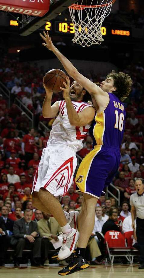 Luis Scola, left, will remain with the Rockets and Pau Gasol will stick with the Lakers after the revived three-team trade that also included the Hornets ended late Saturday night when Los Angeles pulled out of the deal. (Brett Coomer/Chronicle) Photo: Brett Coomer, Houston Chronicle / Houston Chronicle