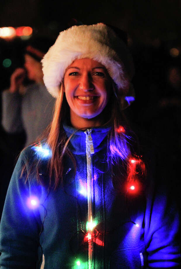Sarah Jane wears festive lights at the Green Lake Pathway of Light celebration at Green Lake Trail in Seattle on Saturday, Dec. 10, 2011. She has been coming for the last 17 years, each year thousands gather to walk around the lake and listen to holiday performances. Many people wear holiday lights or adorn their dogs in them and walk around the lake. This event has been held in Seattle for the past 35 years. Photo: JOE DYER / SEATTLEPI.COM