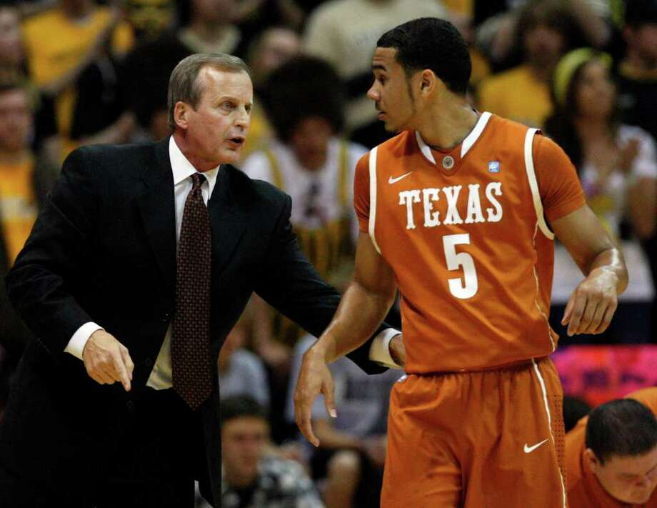 Texas head coach Rick Barnes, left, gives instructions to guard Cory Joseph (5) during the first half of an NCAA college basketball game against Colorado in Boulder, Colo., on Saturday, Feb. 26, 2011. (AP Photo/ Ed Andrieski) Photo: Associated Press