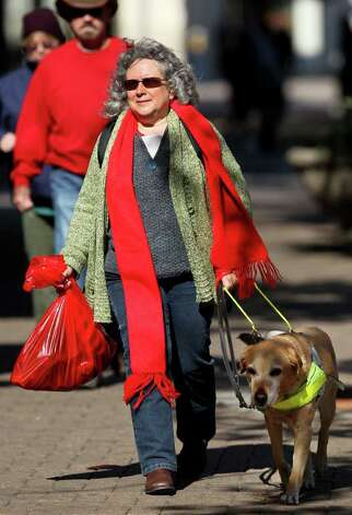 "Lou Anne Williams is sight impaired and with the help of her guide dog ""Bonney"" she navigates through downtown San Antonio with relative ease. Williams volunteers some of her time to Guide Dogs of Texas. (Wednesday December 7, 2011) JOHN DAVENPORT/jdavenport@express-news.net Photo: JOHN DAVENPORT, SAN ANTONIO EXPRESS-NEWS / SAN ANTONIO EXPRESS-NEWS (Photo can be sold to the public)"