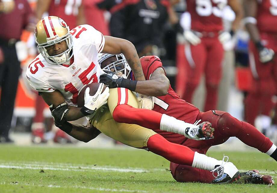 San Francisco 49ers' Michael Crabtree (15) makes a catch in front of Arizona Cardinals' Patrick Peterson during the second quarter in an NFL football game, Sunday, Dec. 11, 2011, in Glendale, Ariz.(AP Photo/Ralph Freso) Photo: Ralph Freso, AP
