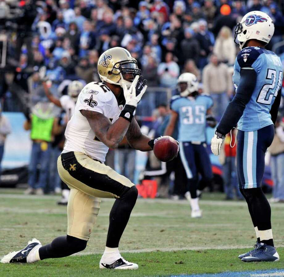 FREDERICK BREEDON: ASSOCIATED PRESS NO MORE HOPE: Marques Colston's fourth-quarter touchdown grab doomed Chris Hope, right, and the Titans. Photo: Frederick Breedon / FR159542 AP