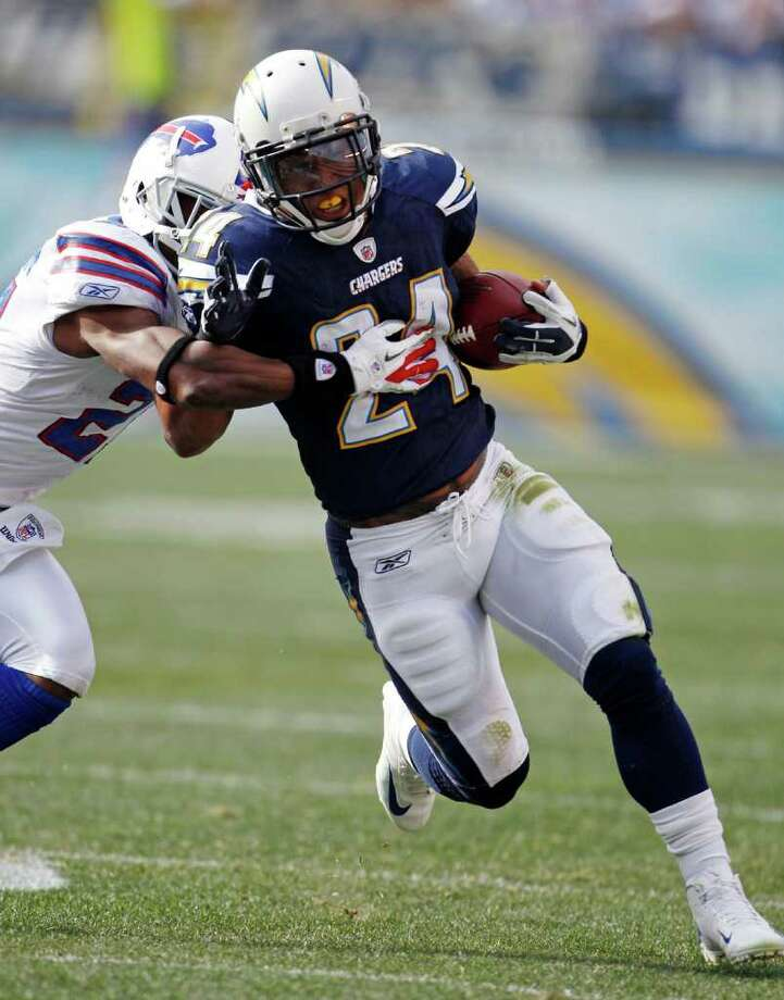 San Diego Chargers running back Ryan Mathews rushes against Buffalo Bills cornerback Leodis McKelvin in the first half of an NFL football game on Sunday, Dec. 11, 2011, in San Diego. (AP Photo/Lenny Ignelzi ) Photo: Lenny Ignelzi
