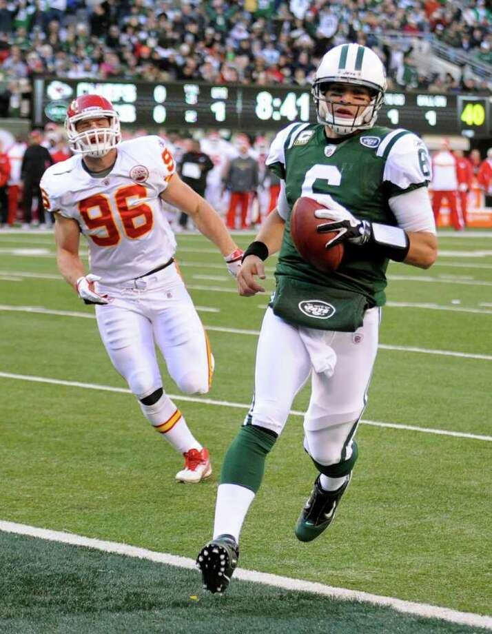 New York Jets' Mark Sanchez, right, runs the ball into the end zone while Kansas City Chiefs' Andy Studebaker follows during the first quarter of the NFL football game Sunday, Dec. 11, 2011, in East Rutherford, N.J. (AP Photo/Bill Kostroun) Photo: Bill Kostroun