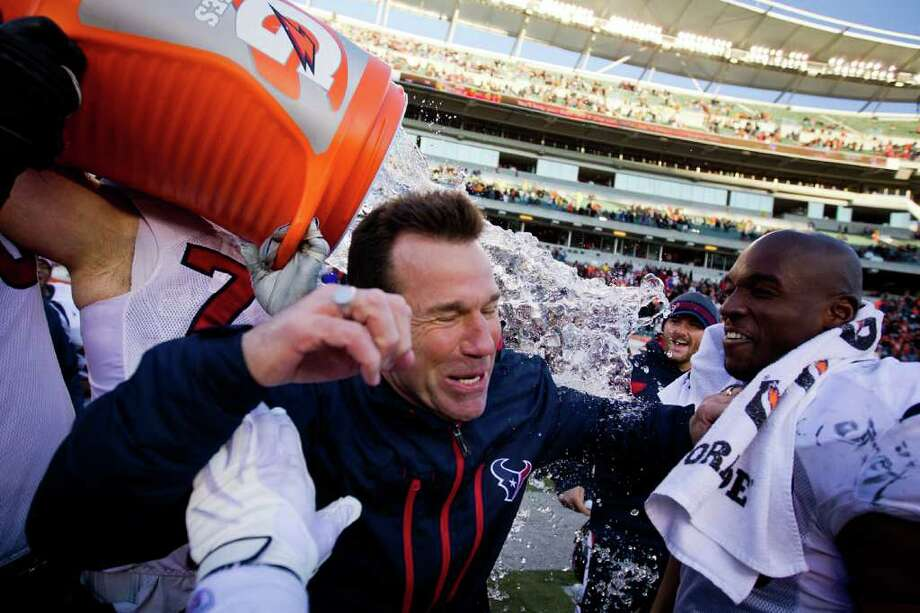 LONG-AWAITED SOAKING: Texans coach Gary Kubiak gets an ice-water dunking from his players as time expires on the team's come-from-behind victory over the Cincinnati Bengals, a win that gave the Texans the AFC South Divison title and the first playoff berth in franchise history. Photo: Smiley N. Pool / © 2011  Houston Chronicle