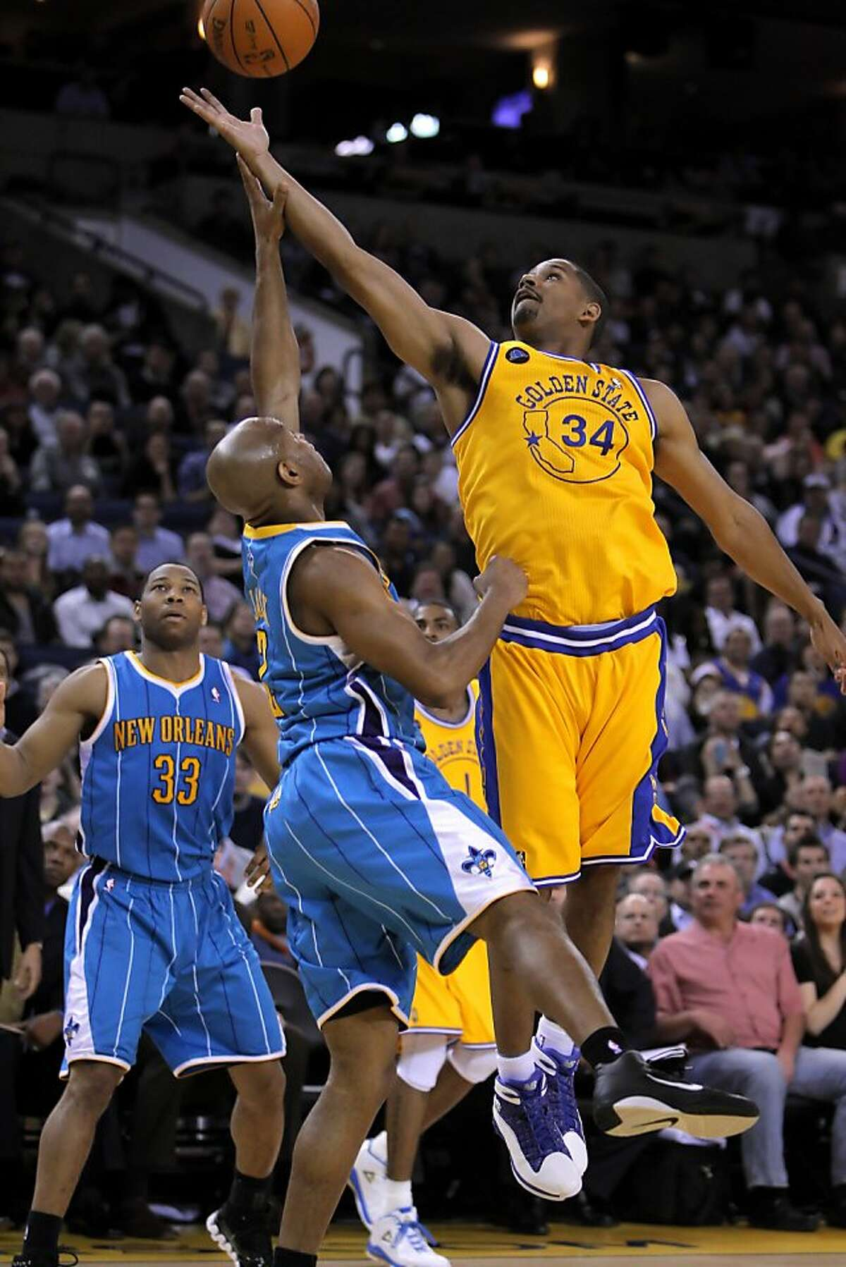 Warriors's Charlie Bell tries to bring in a rebound in the first half. The Golden State Warriors played the New Orleans Hornets at Oracle Arena in Oakland, Calif., on Tuesday, February 15, 2011.