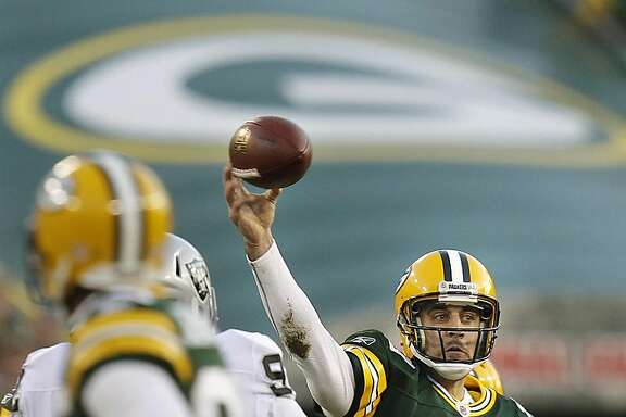 Green Bay Packers quarterback Aaron Rodgers finds James Jones open for a first down in the first quarater against the Oakland Raiders, Sunday, December 11, 2011, Green Bay, Wisconsin. (Rick Wood/Milwaukee Journal Sentinel/MCT)