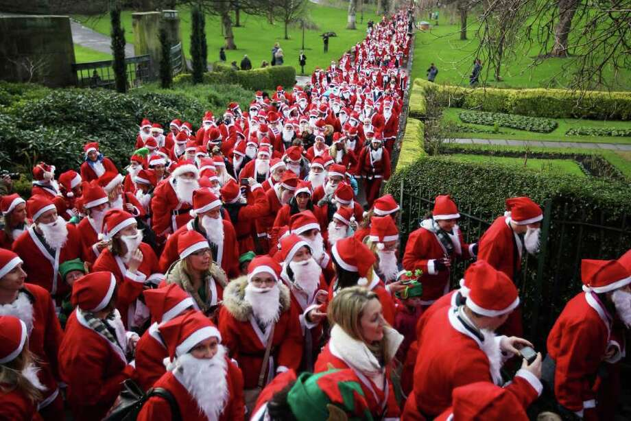 Participants dressed as Santa Claus take part in the Great Edinburgh Santa Run on December 11, 2011 in Edinburgh, Scotland. Around a thousand people took part in the annual fundraising event, with all money raised being donated to the charity 'When You Wish Upon a Star'. Photo: Jeff J Mitchell, Getty / 2011 Getty Images