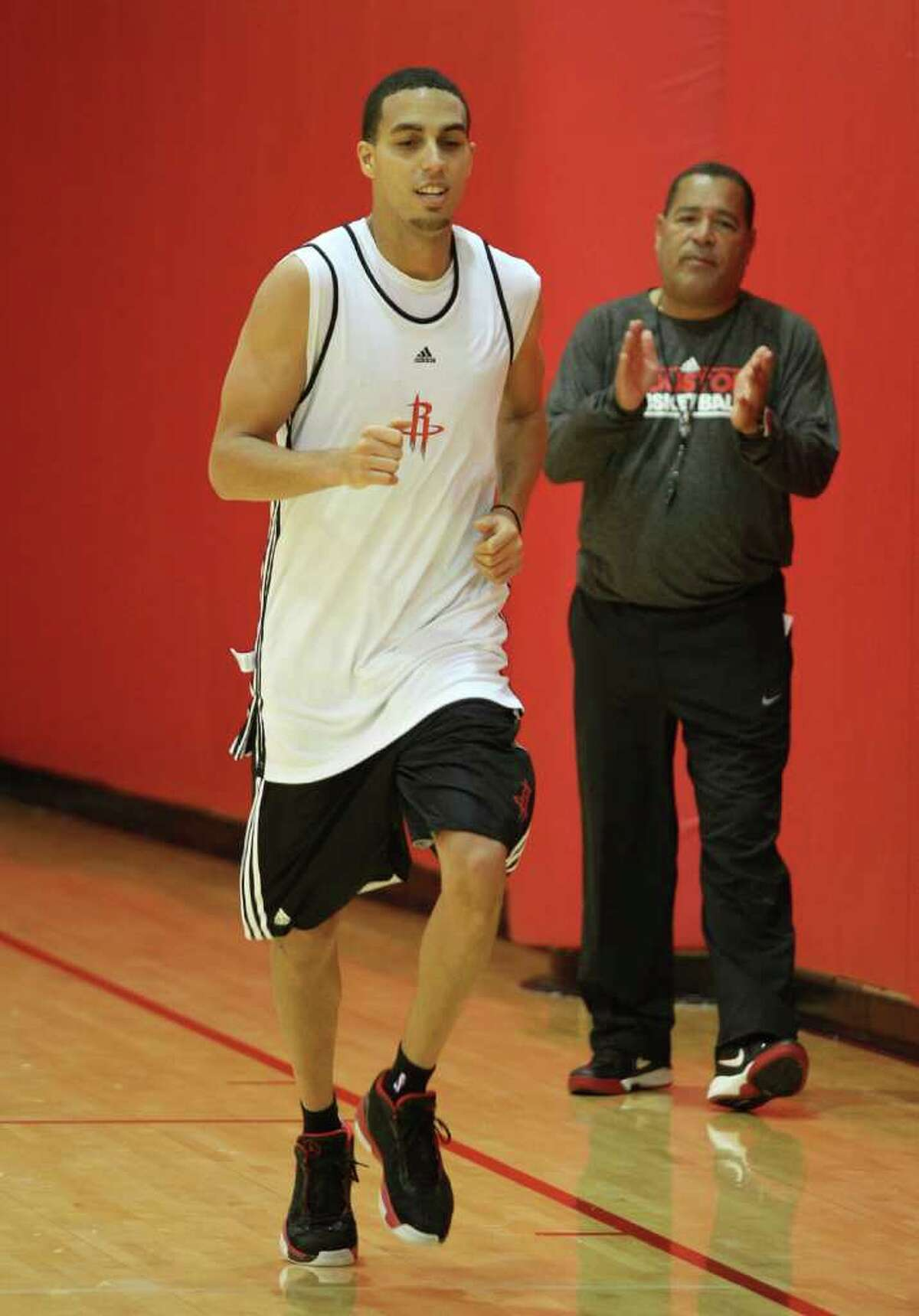 USH THE PACE: Assistant coach Kelvin Sampson encourages Kevin Martin at end-of-practice sprints. Martin, along with Luis Scola, returned to practice Sunday after sitting out Saturday's workouts while in trade limbo.