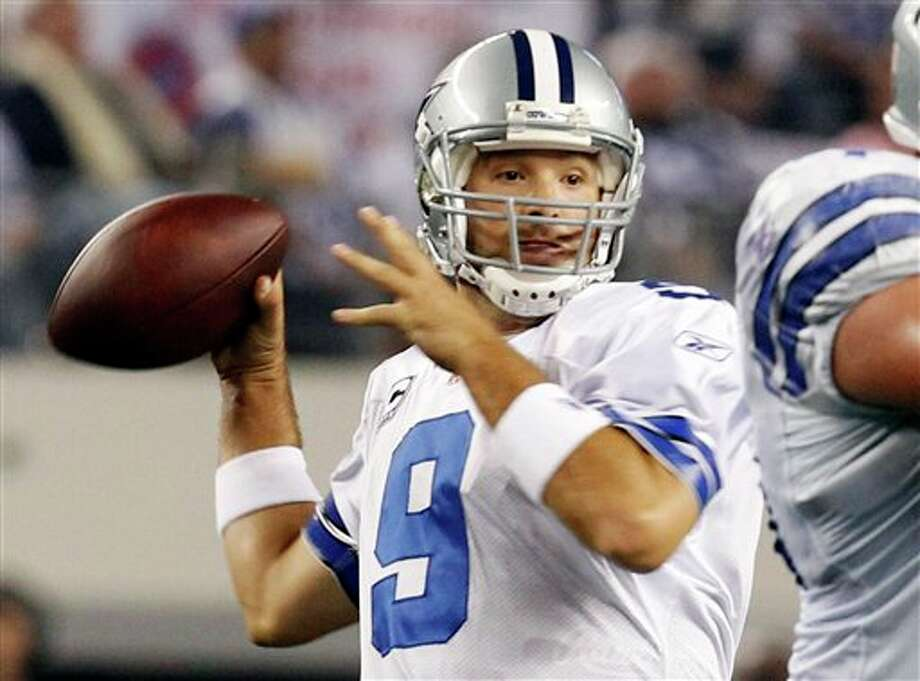 Dallas Cowboys' Tony Romo passes the ball against the New York Giants during the first half of an NFL football game Sunday, Dec. 11, 2011, in Arlington, Texas. (AP Photo/Sharon Ellman) Photo: Sharon Ellman, Associated Press / FR170032 AP