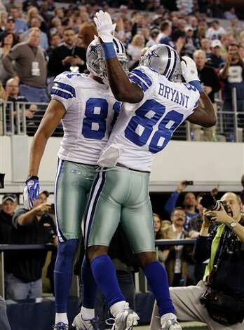 Dallas Cowboys' Laurent Robinson, right, celebrates his touchdown against the New York Giants with  Dez Bryant during the first half of an NFL football game Sunday, Dec. 11, 2011, in Arlington, Texas. (AP Photo/Tony Gutierrez) Photo: Tony Gutierrez, Associated Press / AP