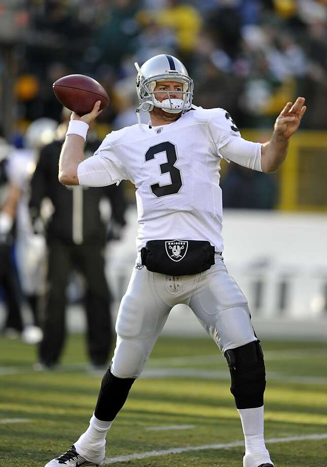 Oakland Raiders quarterback Carson Palmer throws before an NFL football game against the Green Bay Packers Sunday, Dec. 11, 2011, in Green Bay, Wis. (AP Photo/Jim Prisching) Photo: Jim Prisching, AP