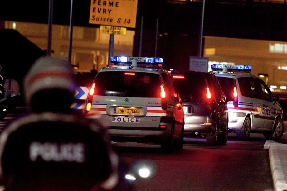 A police car, second from right, believed to be carrying former Panamanian military strongman Manuel Noriega arrives at Orly airport, south of Paris, after leaving La Sante Prison Sunday, Dec. 11, 2011. Noriega left France Sunday for further punishment in his homeland after more than 20 years in U.S. and French jails for drug trafficking and money laundering. (AP Photo/Thibault Camus) Photo: Thibault Camus