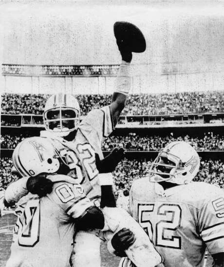 chronicle file A PERRY GOOD DAY: Oilers safety Vernon Perry, hoisted here by Ken Burrough (00) and Robert Brazile (52), thwarted the Chargers' Air Coryell attack with four interceptions in a 17-14 playoff upset in 1979. / Houston Chronicle