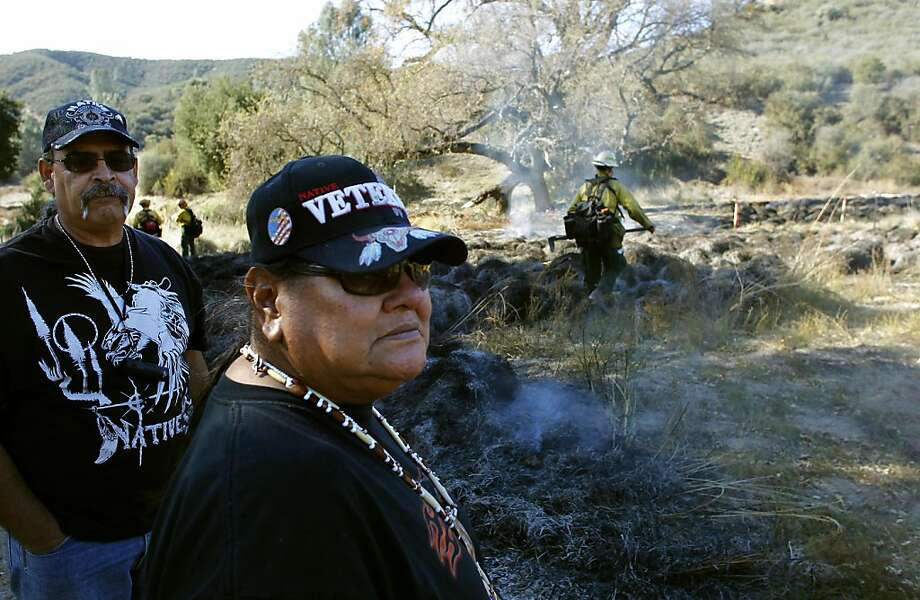 Native Americans Mike Bonillas, (left) and Marvin Marine, at the location of the traditional burn, watch as the operation winds down, at the Pinnacles National Monument in Paicines, Ca., on Thursday December 8, 2011. Fire departments from the National Parks Service, Bureau of Land Management and CAL Fire assist in the control burn of two acres to help duplicate the Native American tradition of burning the deer grasses vital to the tribe's culture. Photo: Michael Macor, The Chronicle
