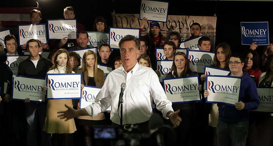 Republican presidential candidate former Massachusetts Gov. Mitt Romney talks to reporters following a campaign stop at a We the People Presidential Forum at the VFW Post, Sunday, Dec. 11, 2011, in Hudson, N.H. (AP Photo/Jim Cole) Photo: Jim Cole, AP