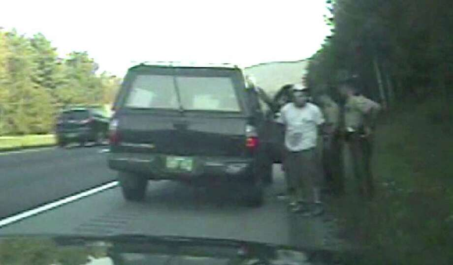 FILE - In this file frame grab from dashboard video provided by the Vermont State Police, troopers stop a vehicle with migrant workers in September 2011 on Interstate 89 in Middlesex, Vt. With more illegal immigrants moving beyond the border states following jobs and and a lack of national immigration reform, some states and communities are coming up with their own policies, written or unwritten, on them. (AP Photo/Vermont State Police, File) / Vermont State Police