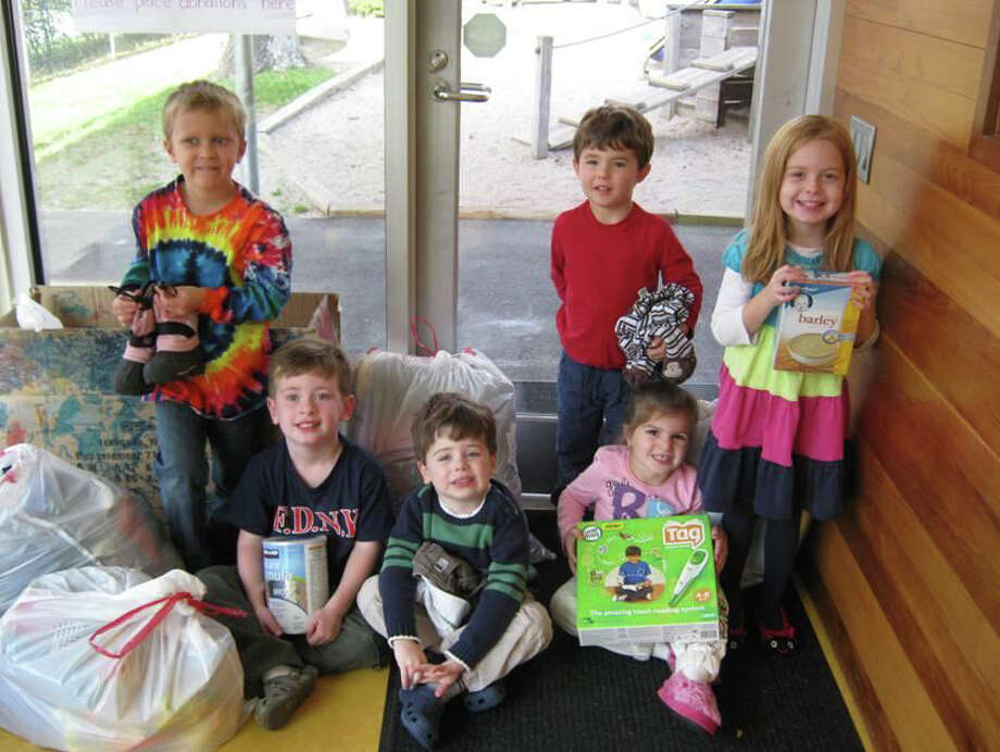 """New Canaan Community Nursery School students participated in their first ever """"Baby Drive"""" to help the new and expectant mothers of need from the Malta House Organization in Norwalk. They pose with items they've collected for the cause. Photo: Contributed Photo"""