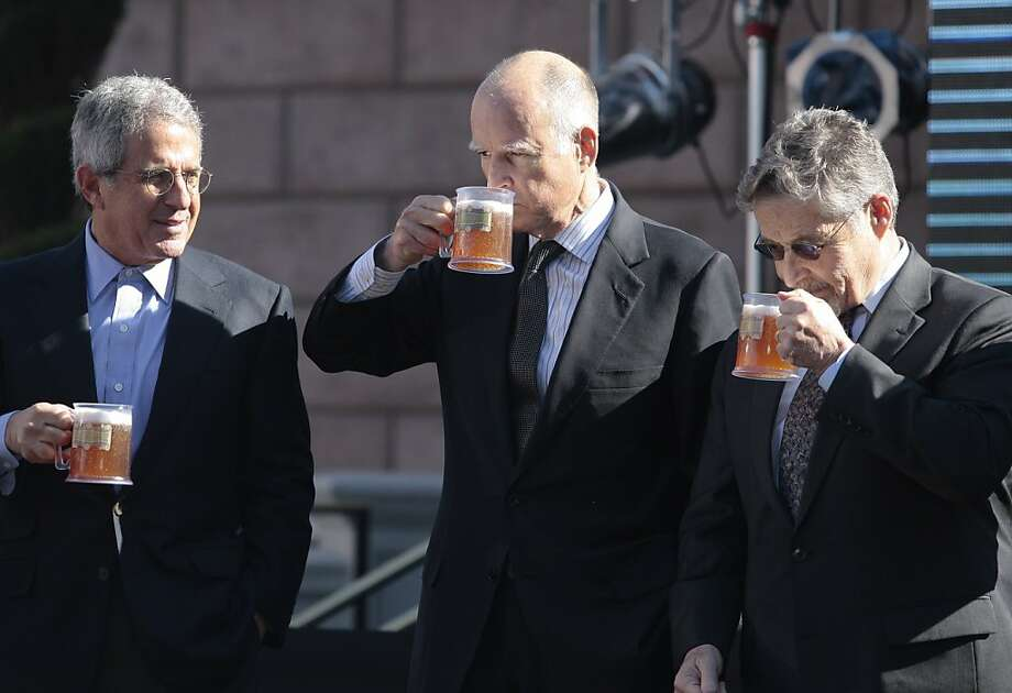 From left, Ron Meyer, President and COO of Universal Studios, Gov. Jerry Brown, and Barry Meyer, Chairman and CEO of Warner Bros. make a butterbeer toast as Universal Parks & Resorts as they announce that the Harry Potter attraction is coming to Universal Studios Hollywood in Universal City, Calif., Tuesday, Dec. 6, 2011. The attraction opened in Orlando, Fla. last summer. (AP Photo/Jason Redmond) Photo: Jason Redmond, AP