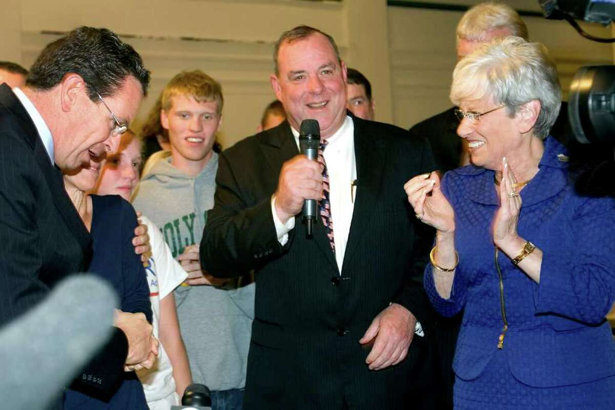 Gov. Dan Malloy with Waterbury Mayor Neil O'Leary and Lt. Gov. Nancy Wyman in Waterbury, Conn. on Nov. 8, 2011, election night. Malloy helped raise money for O'Leary's campaign, including one event on the evening that the first SEBAC deal was doomed to failure.