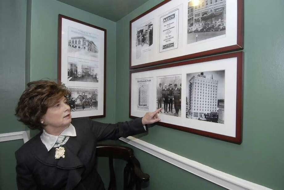 A RICH PAST: In one of several alcoves of historical photos and artifacts at the Lancaster Hotel, Miki Lusk Norton identifies  dignitaries in a photo of the Auditorium Hotel's groundbreaking ceremony on March 1, 1926. Photo: Tony Bullard / Credit: for the Chronicle