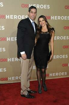 Actress Sofia Vergara, right, and Nick Loeb arrive at the Fifth Annual CNN Heroes: All-Star Tribute in Los Angeles on Sunday, Dec. 11, 2011. (AP Photo/Dan Steinberg) Photo: Dan Steinberg, AP